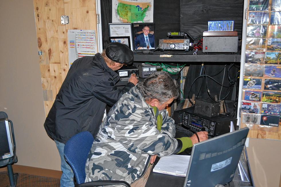 Frank Ross (left) and Don Curtis play with the controls at The Sky is Not the Limit Amateur Radio Club operation at the Discovery Center. (TIM GOODWIN / Insider staff) -