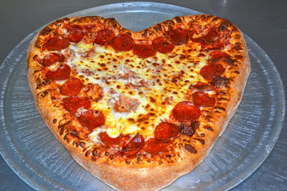 Look at that! It really is a culinary masterpiece. Despite all the moving around that goes on when you put dough, sauce, cheese and pepperoni into a machine that produces intense heat, the pizza holds its shape quite well. (TIM GOODWIN / Insider staff) -