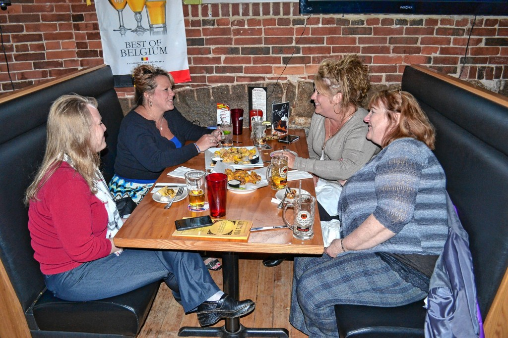 TIM GOODWIN / Insider staffAbove: Nothing says happy hour like a basket of wings. Left: Some lovely ladies enjoy a Tandy's happy hour last week.