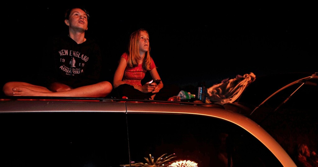 From left, Sydney Carter, 14, and her cousin Ashley Gearing, 11, watch from the roof of a van as fireworks are launched and explode near Memorial Field in Concord on Thursday, July 5, 2012. The firework show was pushed back to Thursday after they were cancelled due to storms in the area on July 4th.(John Tully/ Monitor Staff)Sydney Carter (left) and her cousin Ashley Gearing watch from the roof of a van as fireworks explode near Memorial Field in Concord in 2012.