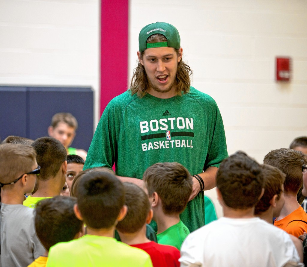 Boston Celtic PF/ C Kelly Olynyk talks with the kids at Matt Bonner's Basketball camp at Abbott-Downing elementary school Thursday.