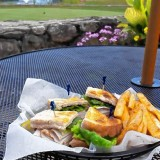 Food Snob: Eating a sandwich while watching some golf