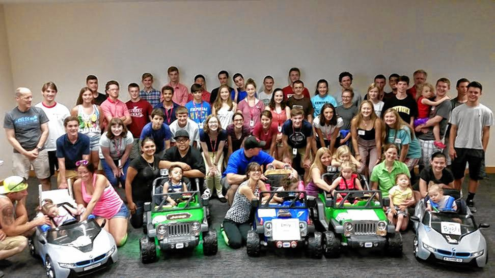 Courtesy—Look at all those happy children and parents that received customized Power Wheels thanks to GoBabyGo New Hampshire and students in the St. Paul's School Advanced Studies Program.