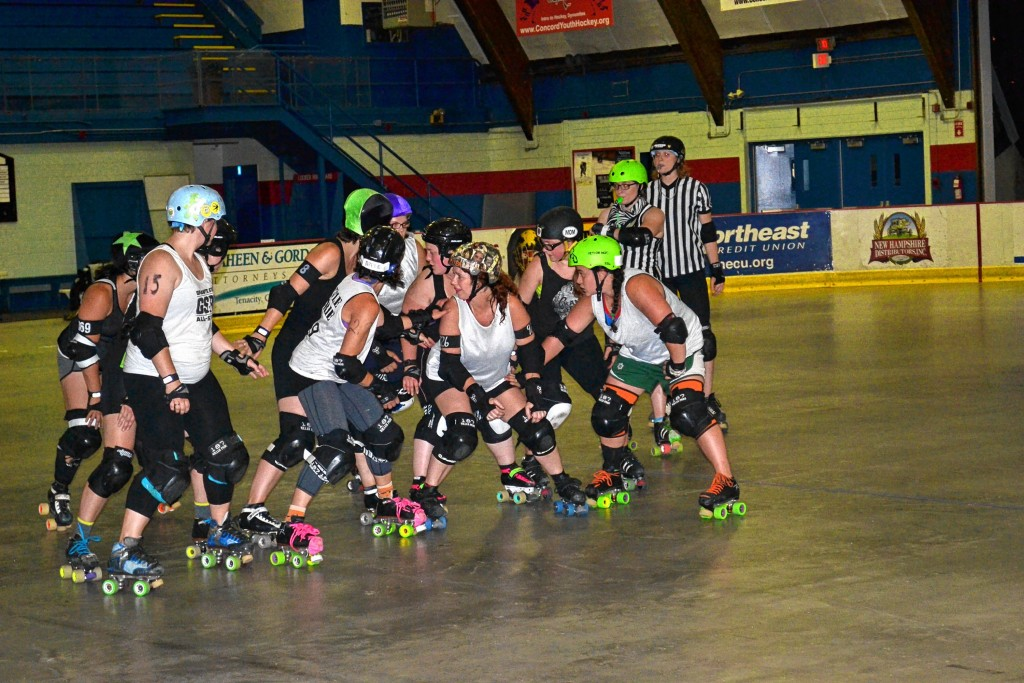 Tim Goodwin / Insider staffThere's a lot of crashing and falling when the Demolition Dames and Fighting Finches square off, like what will happen when they roll around the Everett Arena track Saturday.