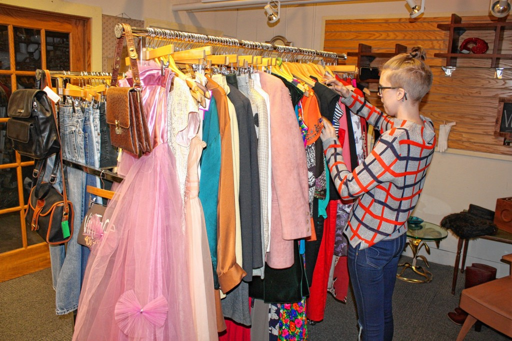 JON BODELL / Insider staff—Lilise owner Elyssa Alfieri picks out some vintage pieces from the store's vintage rack. In case you were wondering, vintage clothing is defined as being at least 20 years old.