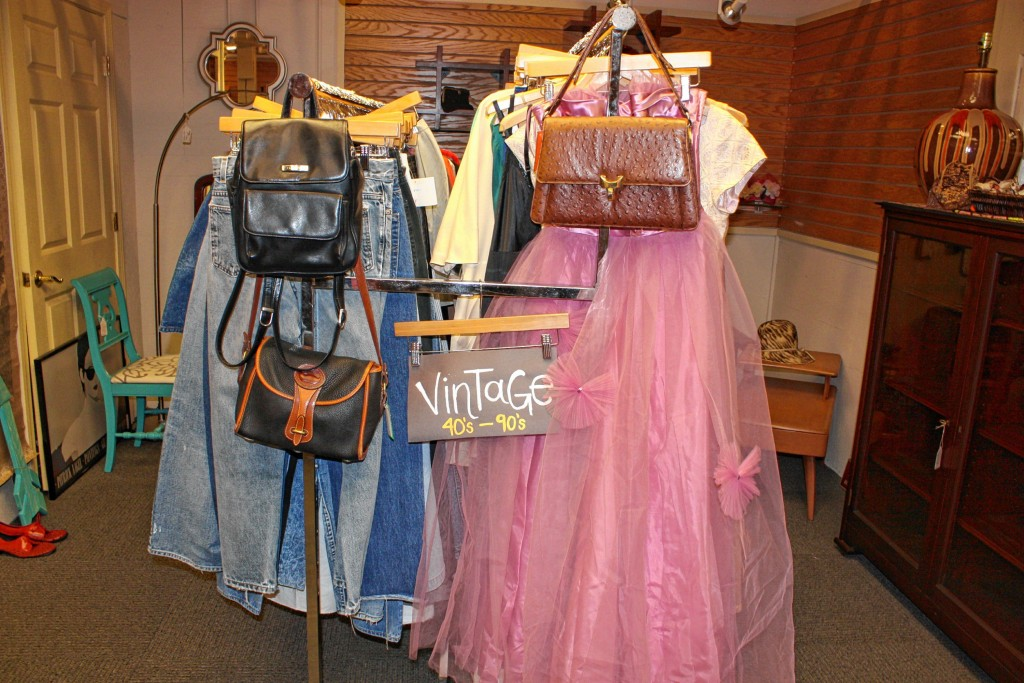 JON BODELL / Insider staffLilise owner Elyssa Alfieri pokes through a rack of vintage clothes at the store last week.