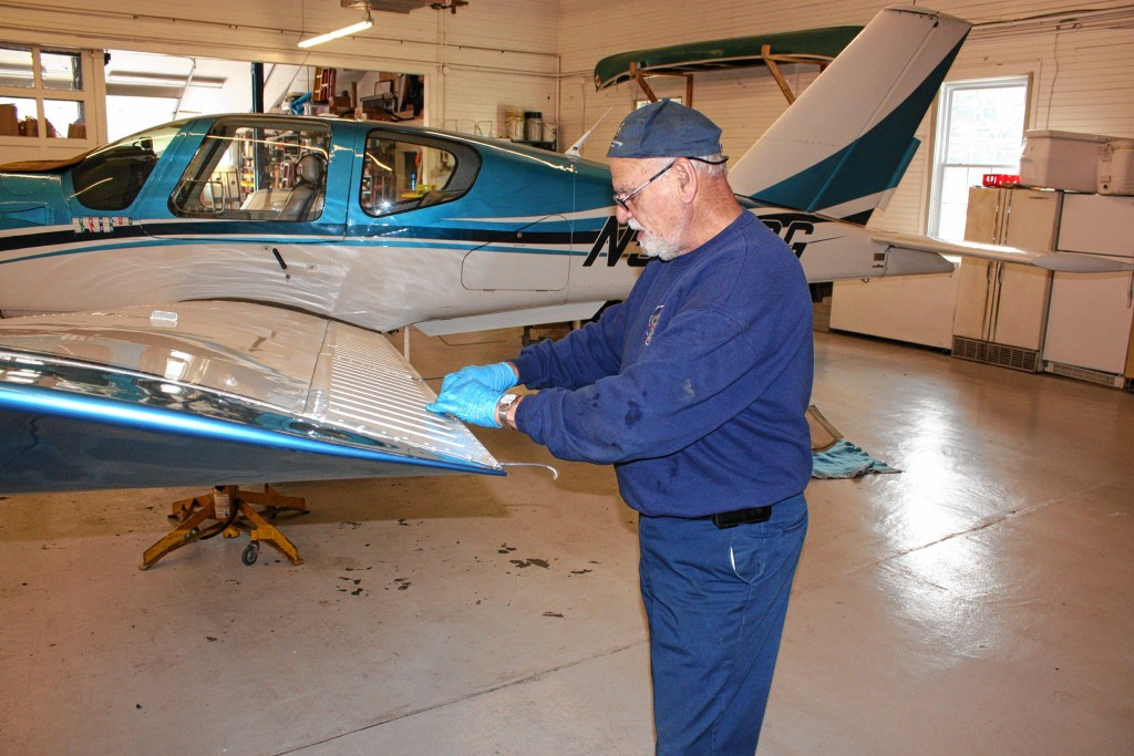 JON BODELL / Insider staff—Concord Aviation Services airplane mechanic Dick Meyers goes over some of the details of inspecting and working on an airplane at Concord Regional Airport last week.