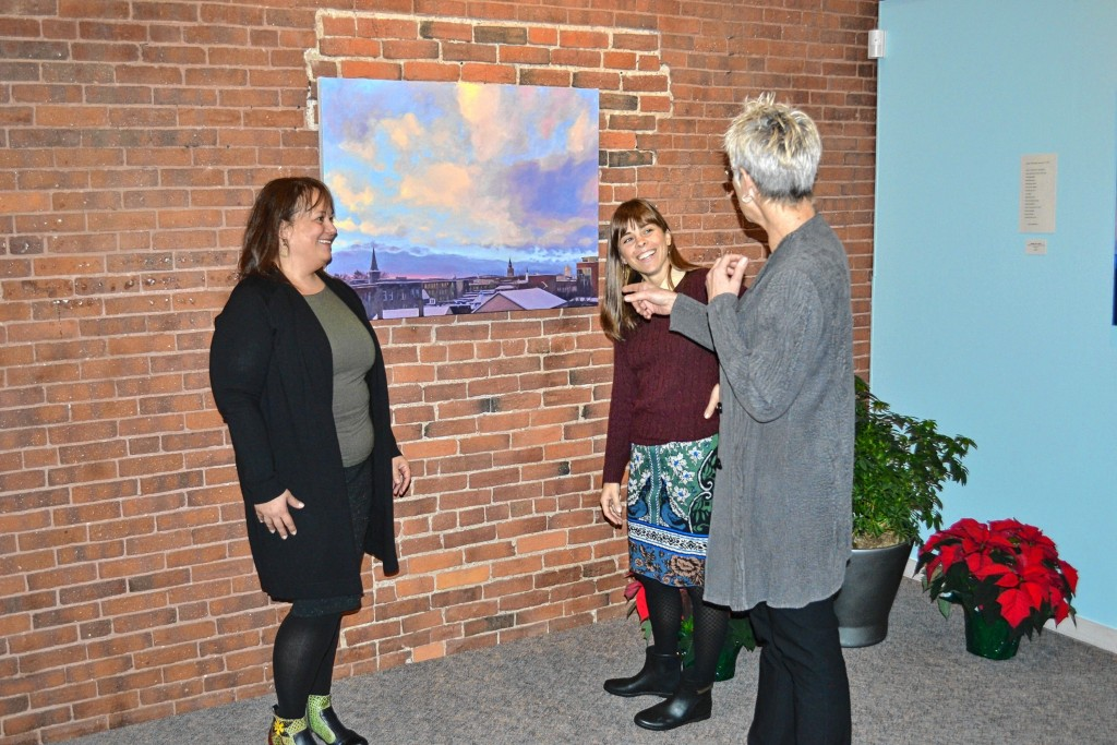 Intown Concord Executive Director Michelle Motuzas Johnson (left) and Kate Fleming, Intown's events and outreach coordinator (right), talk with McGowan Fine Art owner Sarah Chaffee after a meet and greet at the gallery last week.