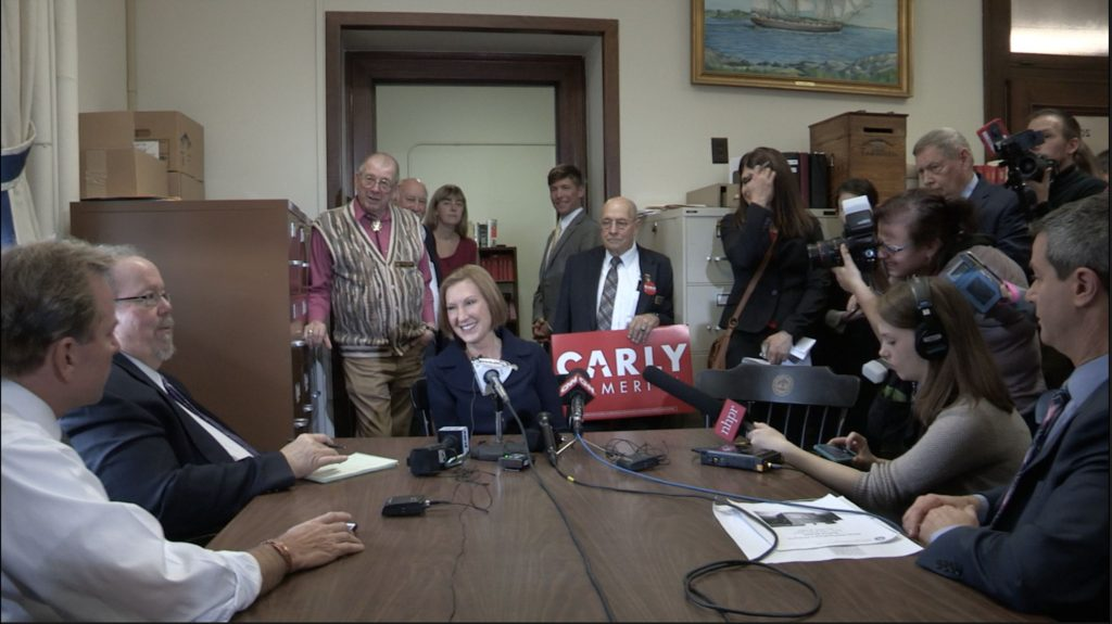 This scene from Democracy Through the Looking Glass shows presidential candidate Carly Fiorina fielding questions from New Hampshire reporters while campaigning leading up to the New Hampshire primary.(Courtesy of Kevin Bowe)