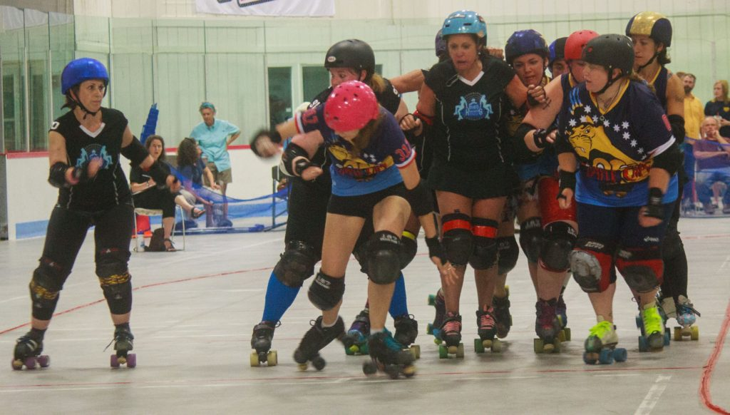 Fawkes' Fyre (left) uses an opening on the outside to become the Lead Jammer during a jam. July 23, 2016 (JENNIFER MELI / Monitor Staff)