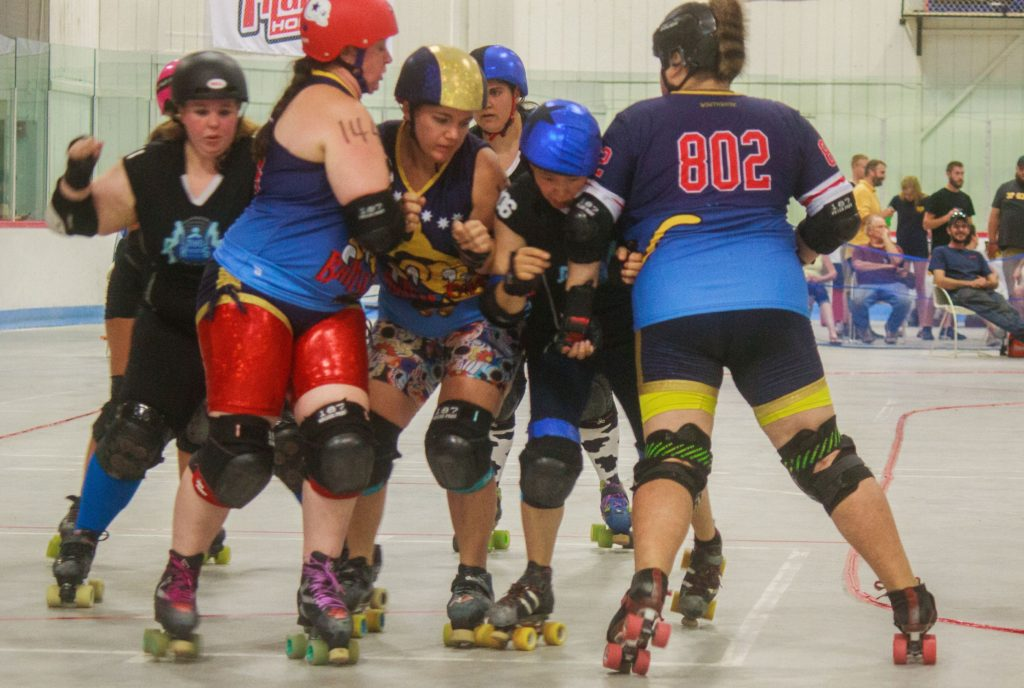 The Jammers try and fight their way through the Blockers. July 23, 2016 (JENNIFER MELI / Monitor Staff)