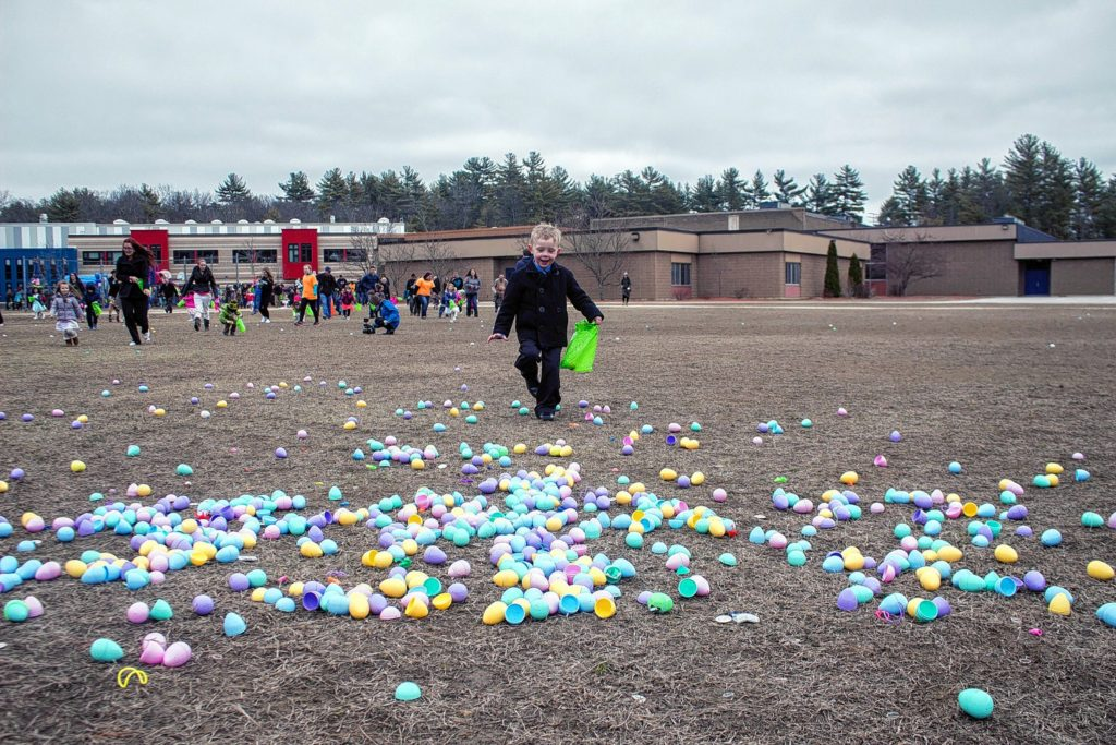 Carden Aldridge, 4, of Concord, is the first to make it to the freshly-dropped eggs behind Mill Brook School Sunday.
