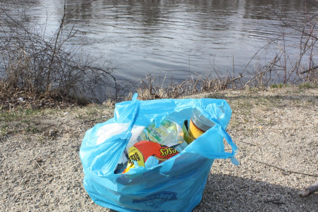 After honestly only about 5 minutes, we filled up this whole shopping bag with trash we collected from the edge of the Merrimack River at Kiwanis Riverfront Park (Everett Arena).