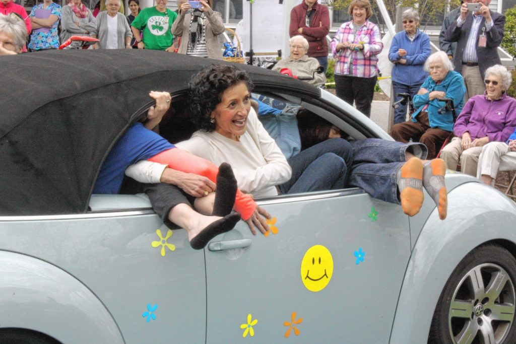 Staffers at Havenwood Heritage Heights teamed up last week to see who could fit more adults into a Volkswagen Beetle. Havenwood is celebrating its 50th anniversary all year long, and the Stuff a Bug competition was the latest installment of fun activities going on throughout the year. After a lot of contorting, cramming and twisting, both teams -- Stuffed Bugs (green) and Herbie's Love Children (blue) -- managed to stuff 16 adults into a staffer's 2004 convertible Beetle. After an odd tie-breaker, which ended up being based on the age of the first person into the car for the second team, the Stuffed Bugs were determined the winners. Though when you pack 16 adults into a little bug, everybody is a winner -- especially those in the audience. JON BODELL / Insider staff