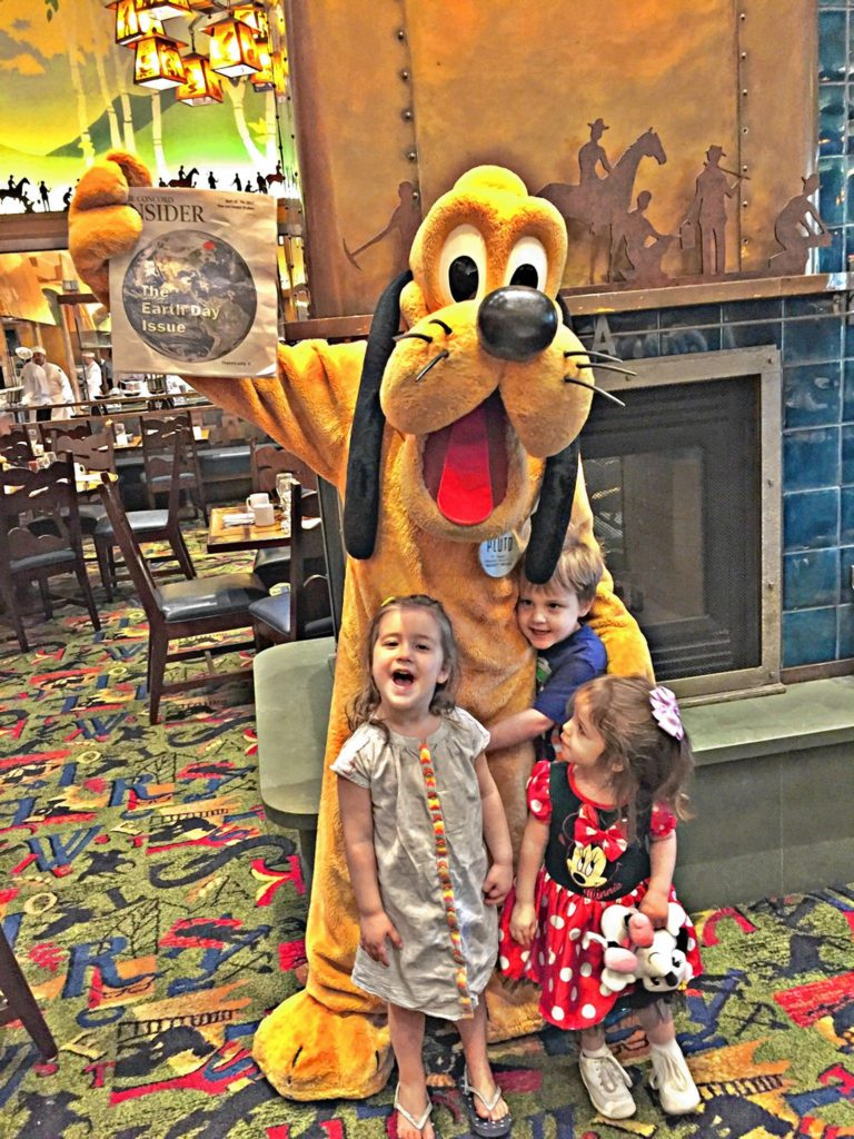 Jon's daughter, Julia (right), and her cousins Mia and Finn got to meet Pluto at Disneyland in Anaheim, Calif., last month, and Pluto was all excited to take a picture holding a copy of the Insider, which he apparently keeps with him at all times.  AIMEE LAROCHELLE / For the Insider
