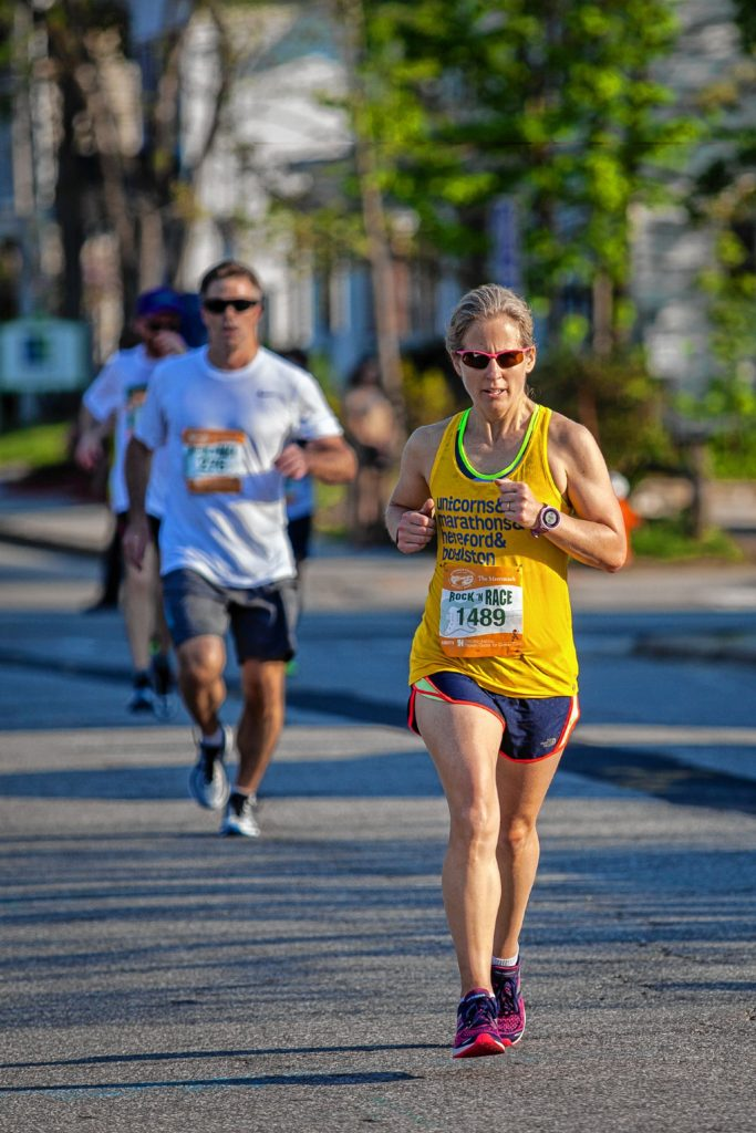 Maryn Barrett approaches the final stretch of the Rock 'N Race 5K in downtown Concord on Thursday, May 18, 2017. (ELIZABETH FRANTZ / Monitor staff) Elizabeth Frantz