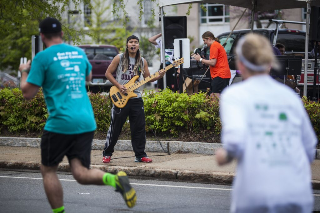 The Fletchtones perform as runners pass by during the Rock 'N Race last year.