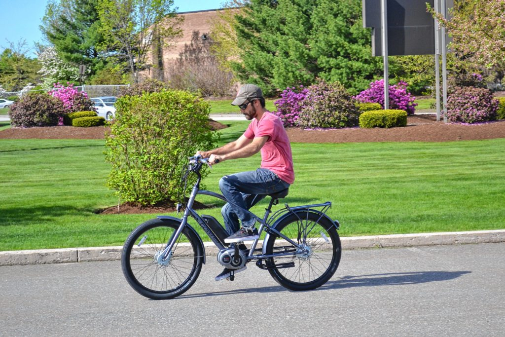 Jon takes the Electra Townie Go! for a spin around the parking lot at Goodale's Bike Shop last week. His first time ever riding an electric motorized bike was a thrilling one. TIM GOODWIN / Insider staff
