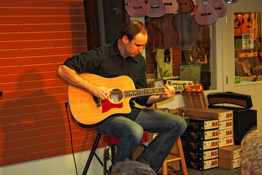 Professional guitarist Brad Myrick plays during a guitar clinic at Strings and Things this past Sunday. This guy is good!