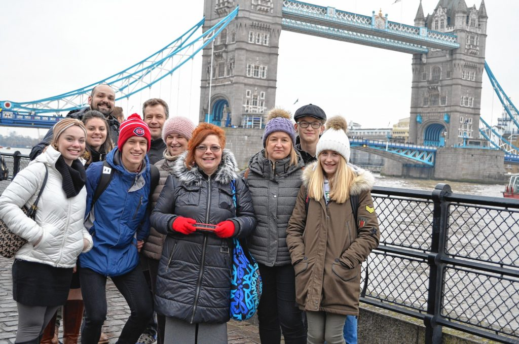 Loic Servais, second from left, with his family and host family during a Christmas break trip to England. Courtesy