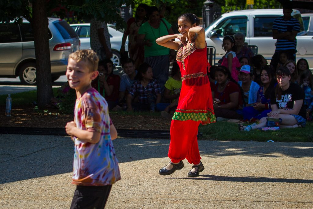 Lochana Sharma (right), 14, and 9-year-old Logan Miller dance to the music during the Concord Multicultural Festival downtown on Saturday, June 25, 2016. (ELIZABETH FRANTZ / Monitor staff) Elizabeth Frantz