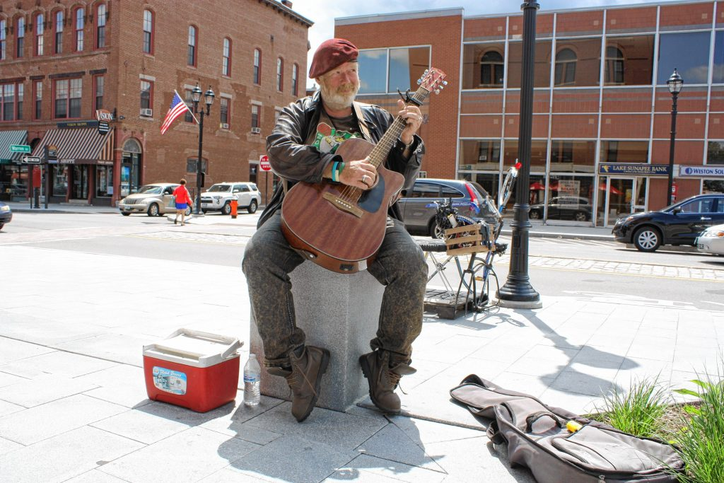 Kevin Clark plays guitar on the sidewalk downtown by Phenix Hall last week. You can see Clark just about every day playing somewhere downtown, usually in front of Eagle Square. JON BODELL / Insider staff
