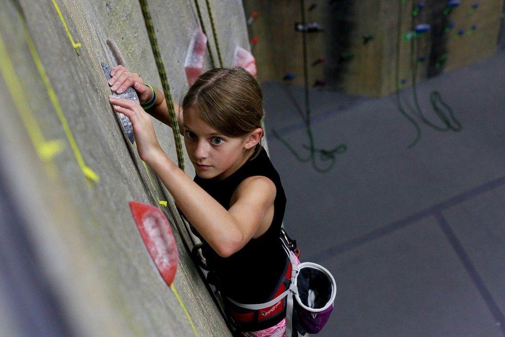 Kira Bergeron of Henniker, 11, climbs a route during practice for Team Evo at Evolution Rock + Fitness in Concord on Thursday, June 12, 2014.  {(credit)}      Ariana van den Akker