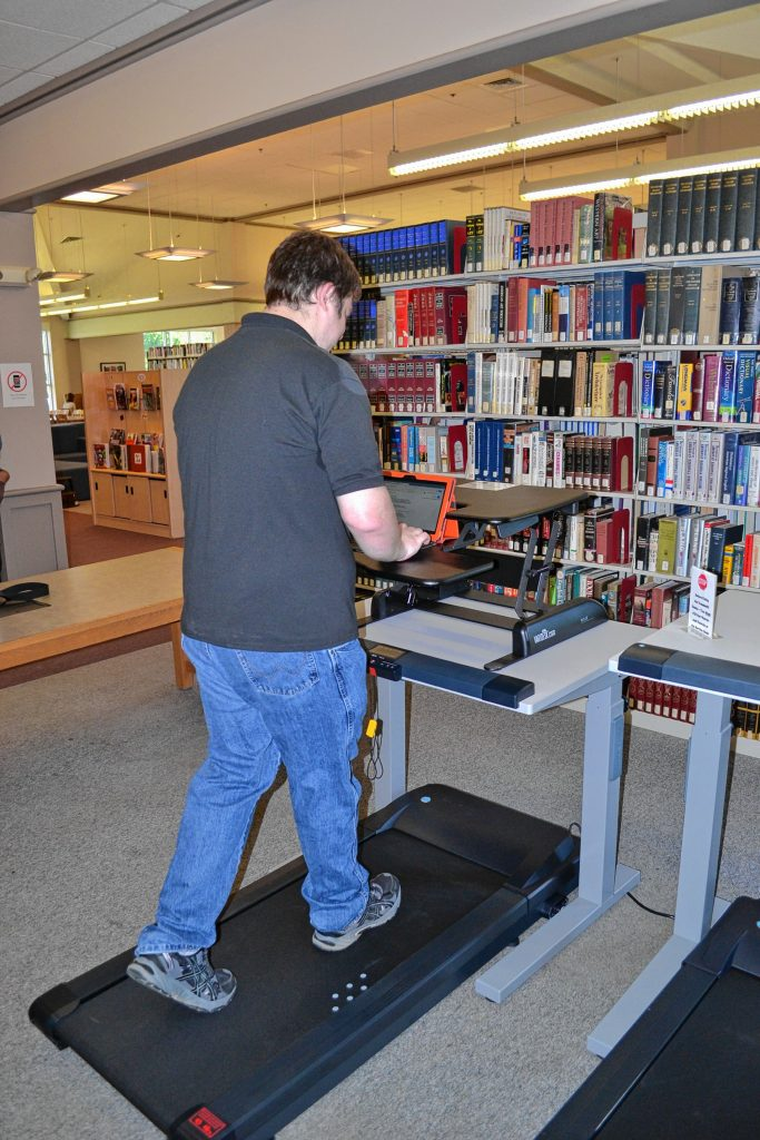 NHTI student Derek White takes the new treadmill desks for a spin last week.  TIM GOODWIN / Insider staff
