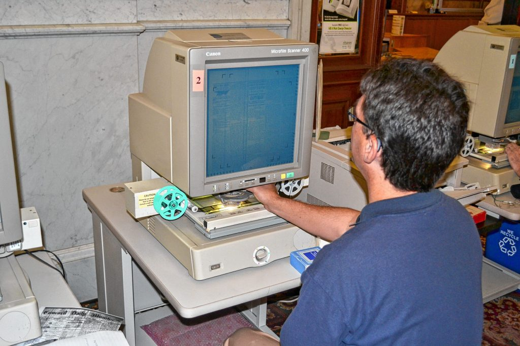 Charles Shipman, supervisor of reference and information services at the N.H. State Library, shows us how to navigate the microfilm collection of Concord newspapers during the Civil War. TIM GOODWIN / Insider staff