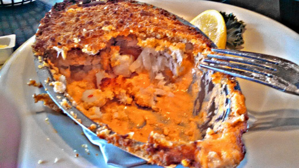 The Seafood Medley from Newick's Lobster House includes a dish of bay scallops, shrimp and haddock baked in a Newburg sauce with Ritz cracker crumb stuffing, mashed potatoes (with a side of gravy) and coleslaw. THE FOOD SNOB / Insider staff