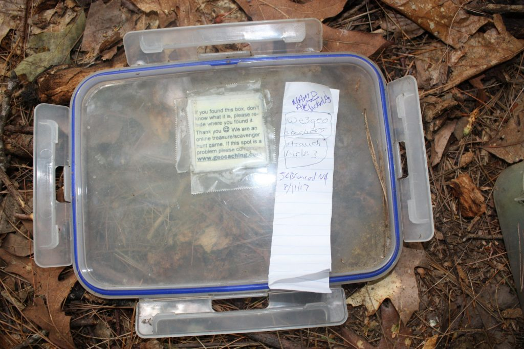 Here's the lid of the first Geocache we found at Sewalls Falls. On top of it is the log, which Jon signed. JON BODELL / Insider staff
