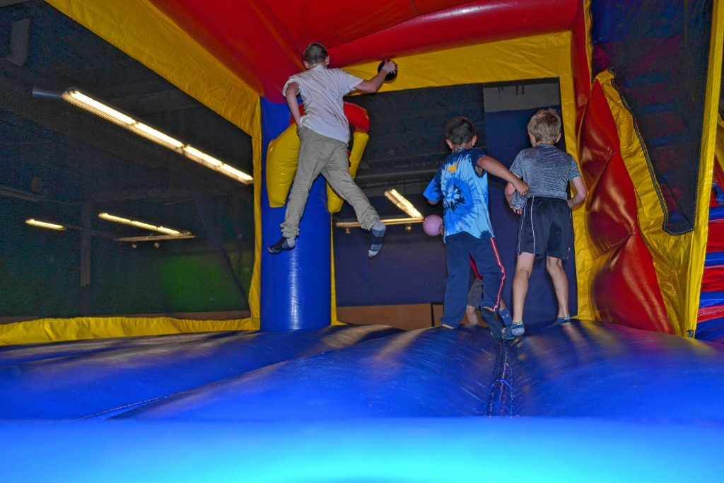 Nothing says a fun night out like jumping around on some inflatable bounce houses. TIM GOODWIN / Insider staff