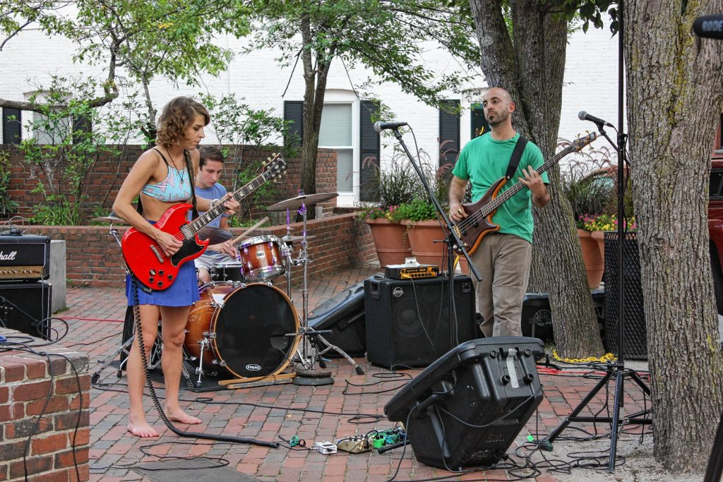 People Skills performs in Bicentennial Square in front of True Brew Barista on July 21. This was the first outdoor concert of the season for True Brew, which hosts live music every weekend.  JON BODELL / Insider staff