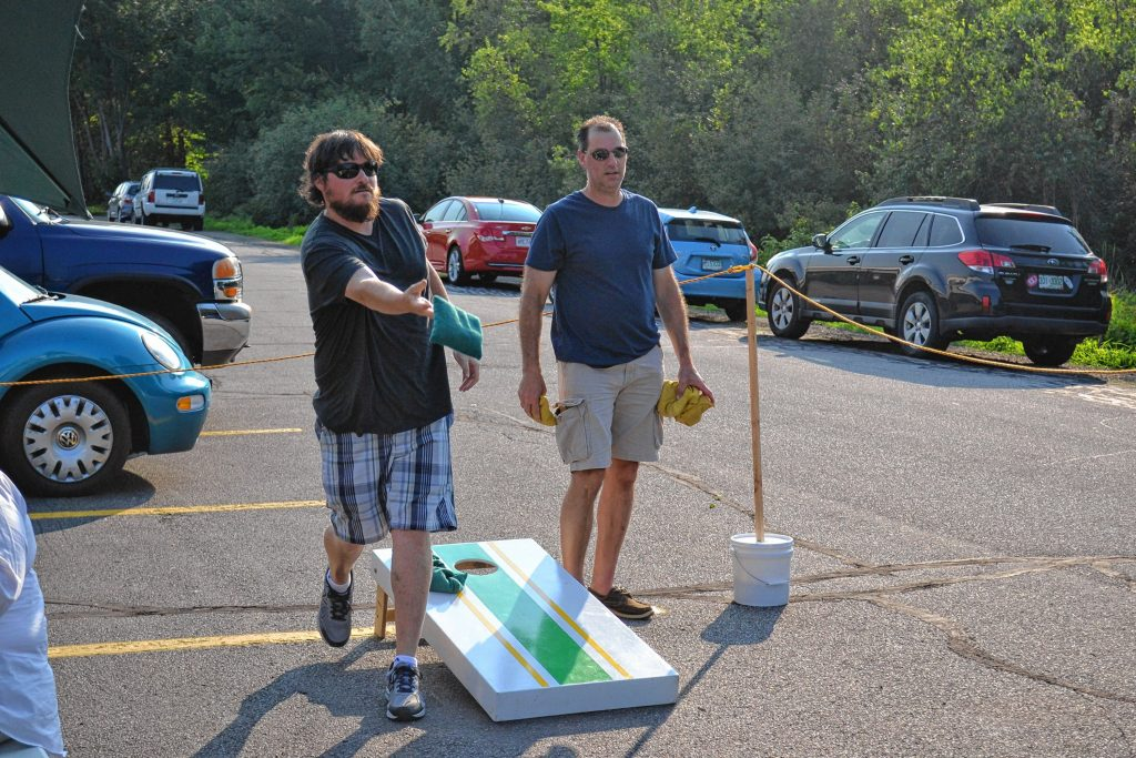 Tim plays a round of cornhole at Lithermans Limited with patron Brian Peters on July 21. The Hall Street brewery now serves full pints and offers an outdoor seating area featuring the popular bean bag-toss game. JON BODELL / Insider staff