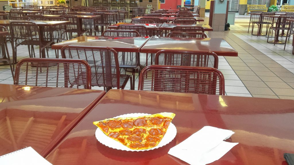 Tim grabbed a slice of pizza from Basil Pizza & More at the Steeplegate Mall last week. There were plenty of seats available in the food court. TIM GOODWIN / Insider staff