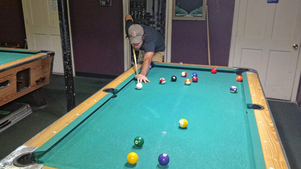 Jon lines up a shot on the pool table at Chi Cha Hookah Bar and Smoking Lounge on July 21. He handled Tim with ease in this round of 8-ball. TIM GOODWIN / Insider staff