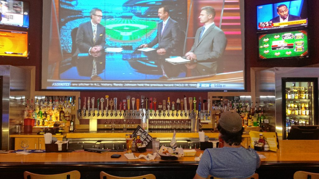 Jon watches Tom Caron, Tim Wakefield and Lenny DiNardo break down the Red Sox game at Buffalo Wild Wings last week. That projection screen is awesome for watching a game. TIM GOODWIN / Insider staff