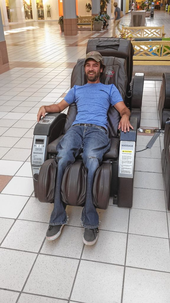 Jon gets an awkward and at times uncomfortable massage from a chair at Steeplegate Mall last week. For just one dollar, you can get a full 3-minute massage, with lots of control over the massage intensity and patterns. TIM GOODWIN / Insider staff
