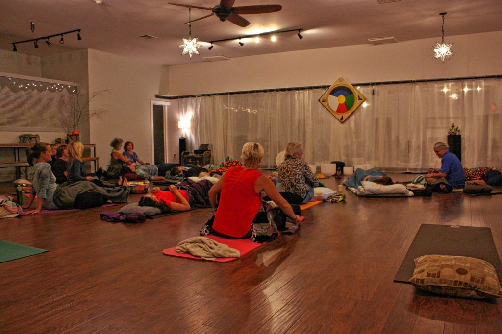 People relax as they wait for the singing bowls sound meditation session to begin at Back in Motion last week. JON BODELL / Insider staff