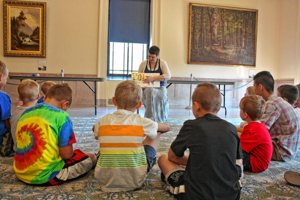 Mary Morris reads to kids during Tales of New Hampshire Family Story Time at the New Hampshire Historical Society in Concord last Tuesday. The event is part story time, part history lesson, as kids learn about how we got to where we are today. JON BODELL / Insider staff
