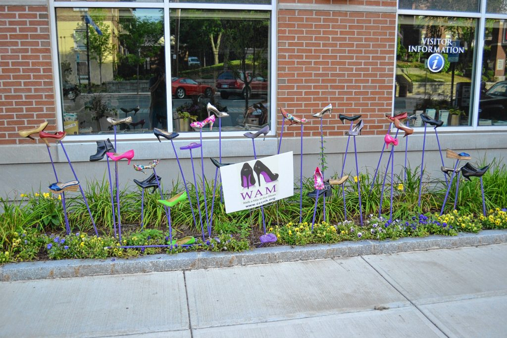 A shoe art installation in front of the Smile Building on South Main Street should be a big hint that it's time to sign up for Walk A Mile in Her Shoes. TIM GOODWIN / Insider staff
