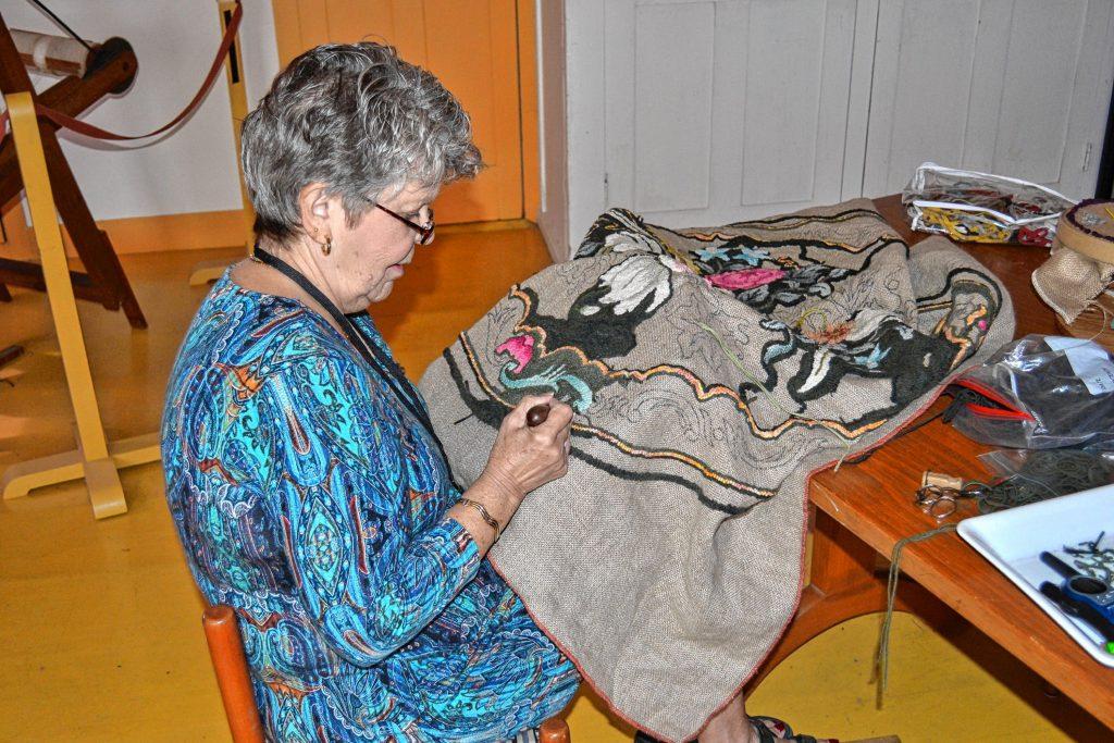 Carol Lachance puts on a rug hooking demo at Canterbury Shaker Village. Tim Goodwin / Insider staff