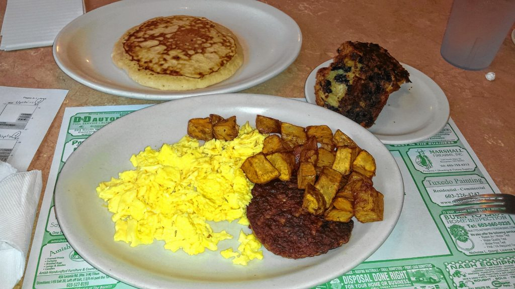 We ate the half farmers at Newell Post, which features two eggs, home fries, a pancake, bacon and sausage – and added a grilled blueberry muffin. Tim Goodwin / Insider staff