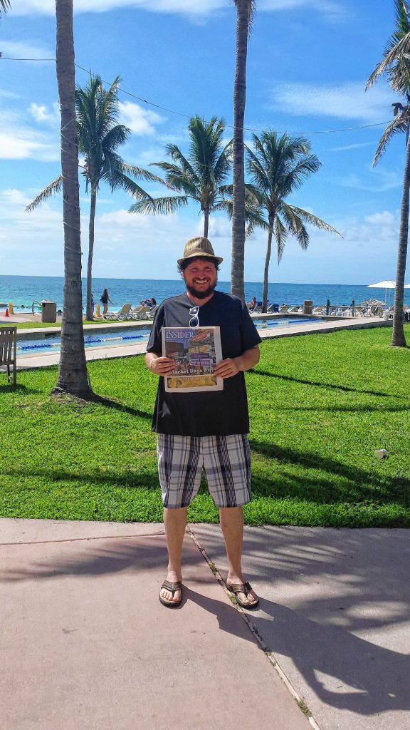 During a trip to Freeport, Bahamas for a friend's wedding, Tim brought along the Market Days Issue. Dan Patnode / For the Insider