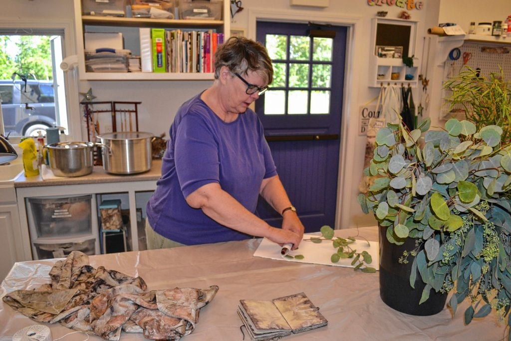 Twiggs Gallery owner Adele Sanborn prepares material for an upcoming class. Tim Goodwin / Insider staff