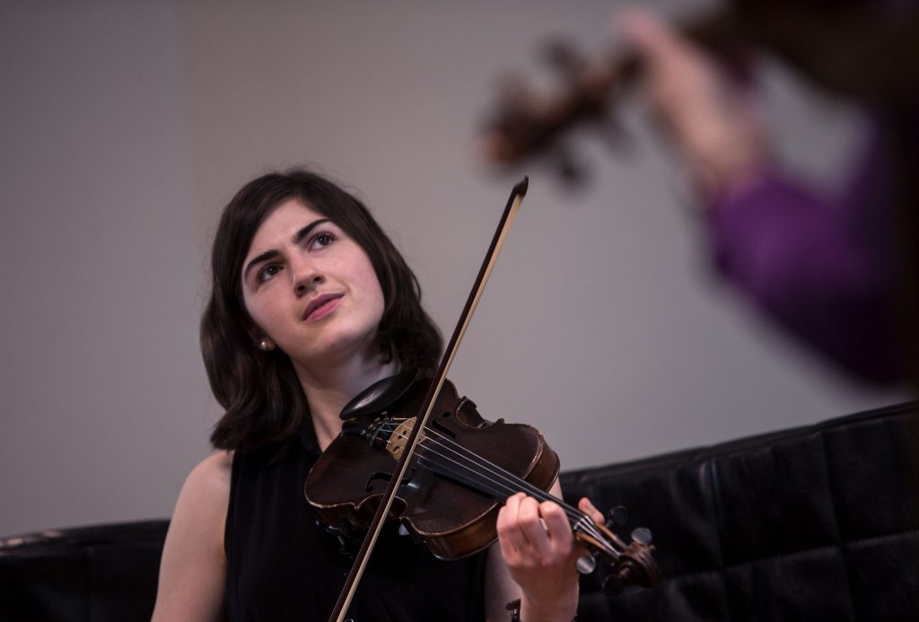 Elizabeth Faiella watches her students as they play Irish tunes at the Fall Fiddle Festival at the Concord Community Music School Saturday. GEOFF FORESTER