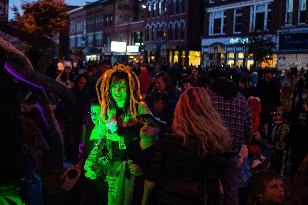 Rebecca Mitchell of Deering, with her sons Josh (left), 12, and Logan, 9, enters Christian Michael Salon as hundreds of families celebrate Halloween Howl by trick-or-treating at businesses in downtown Concord on Friday, October 25, 2013. The salon was inhabited by pirates and a large kraken named Lola.  (WILL PARSON / Monitor staff) Will Parson