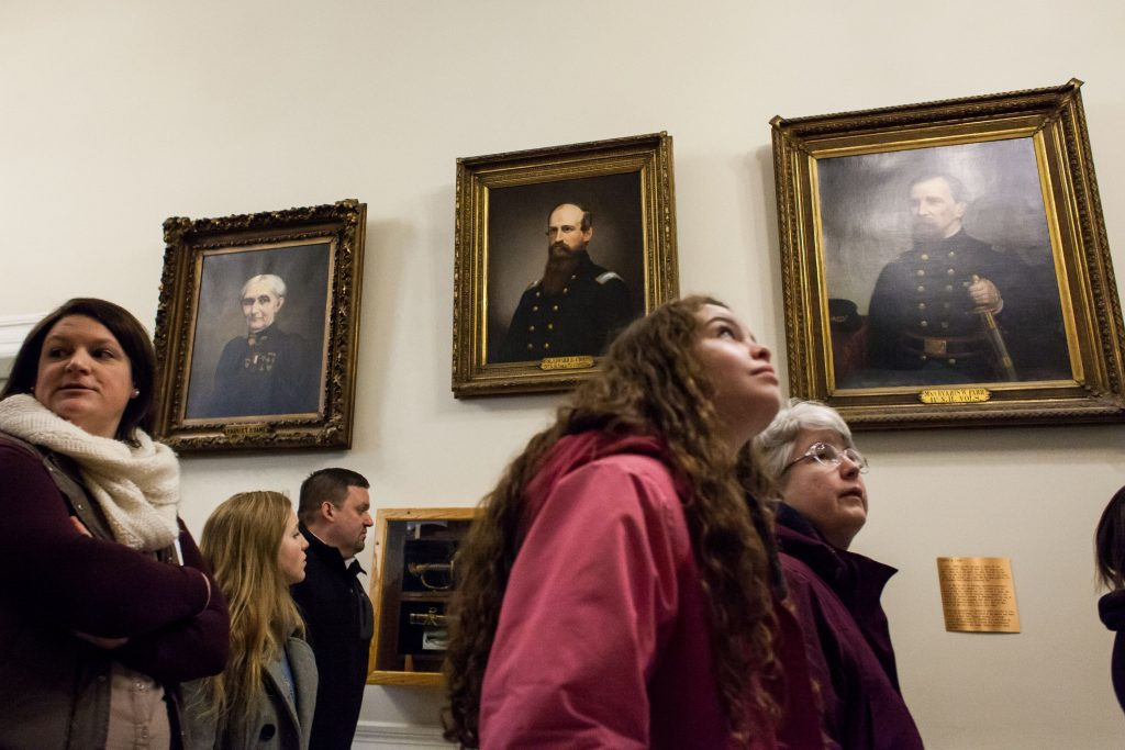 Merrimack Valley High School student Elizabeth West (right), 17, of Loudon, looks up at painting on the wall of the State House in Concord during a tour on Thursday, March 16, 2017. West was on the tour as part of a Daughters of the American Revolution Good Citizens Awards celebration. (ELIZABETH FRANTZ / Monitor staff) Elizabeth Frantz