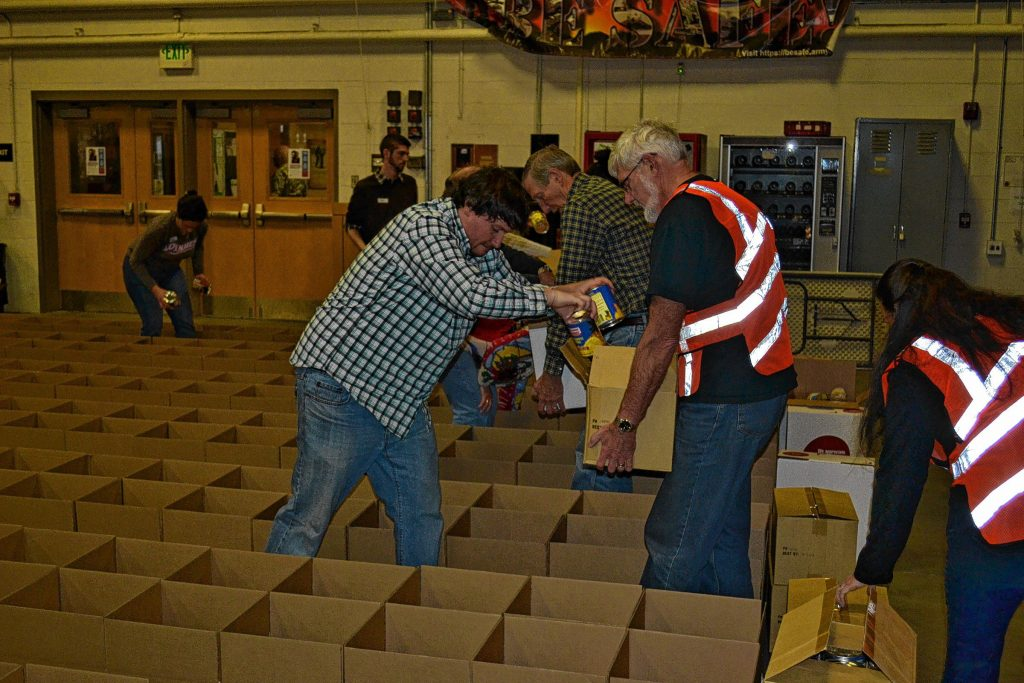 Here's actual proof that I put canned goods in lots of boxes at the Capital Region Food Program's Holiday Basket Project last week.