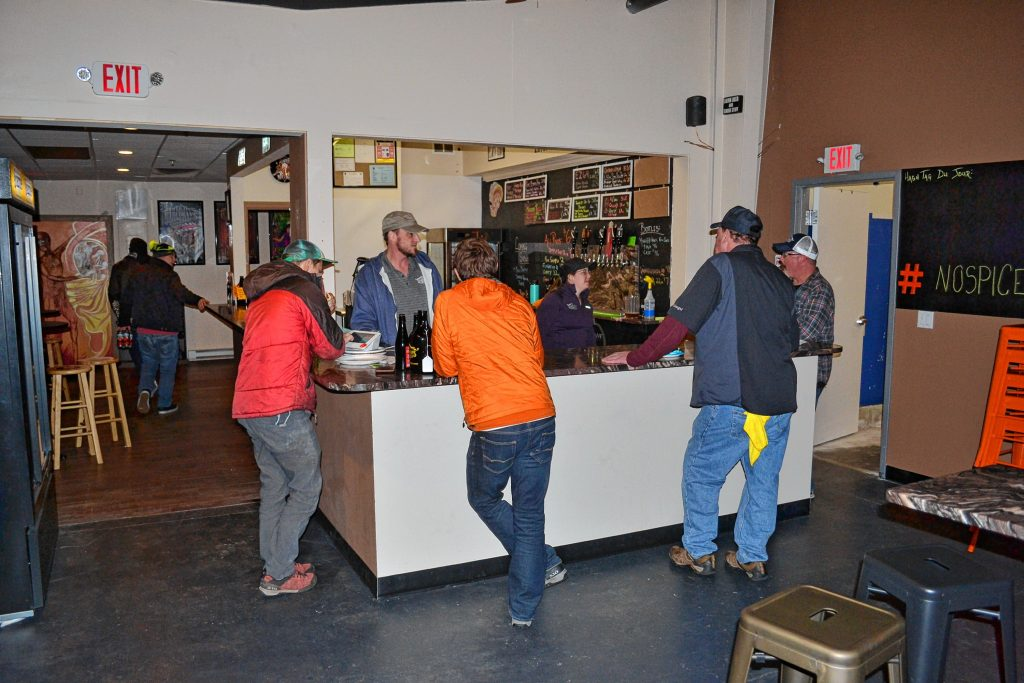 Lithermans co-owner Michael Hauptly-Pierce visits with customers and tap room volunteers at the end of another busy night for the recently expanded craft brewery on Hall Street. TIM GOODWIN / Insider staff